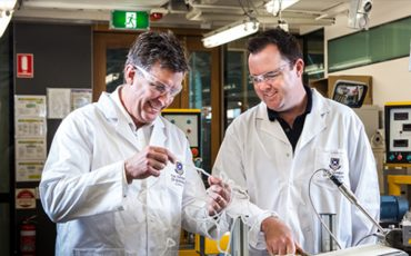 Manildra Group Technical Manager Mark Baczynski with Chemical Engineering Research Fellow Paul Luckman inspect the wheat starch blend. Image courtesy of UQ