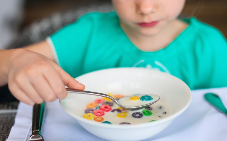 boy eats cereal stock image
