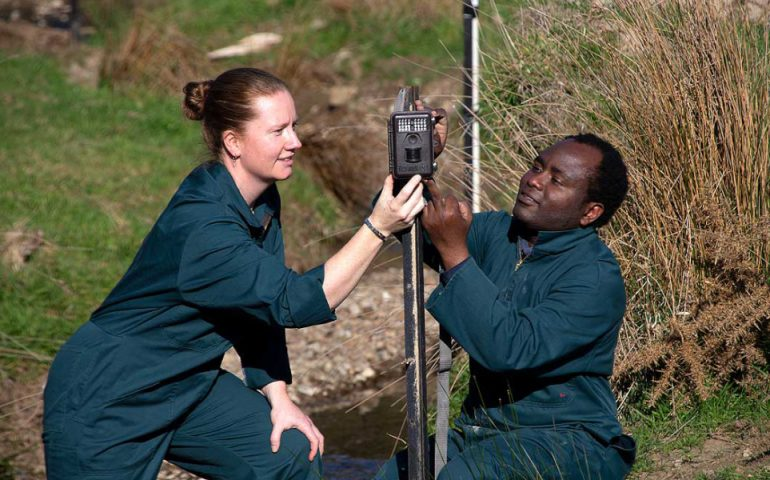 Dr Rene Corner-Thomas and PhD student Aloyce Bunyaga fixing one of the cameras used in the trial.